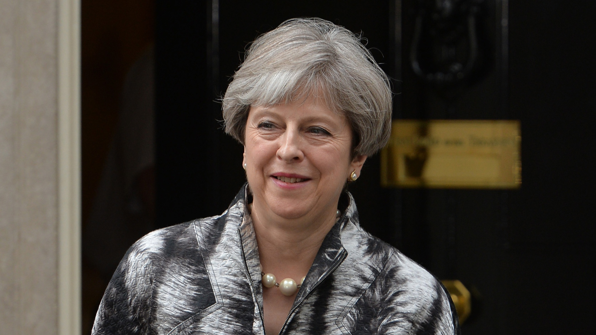 Theresa May to 'get on with job' after ignoring calls for resignation