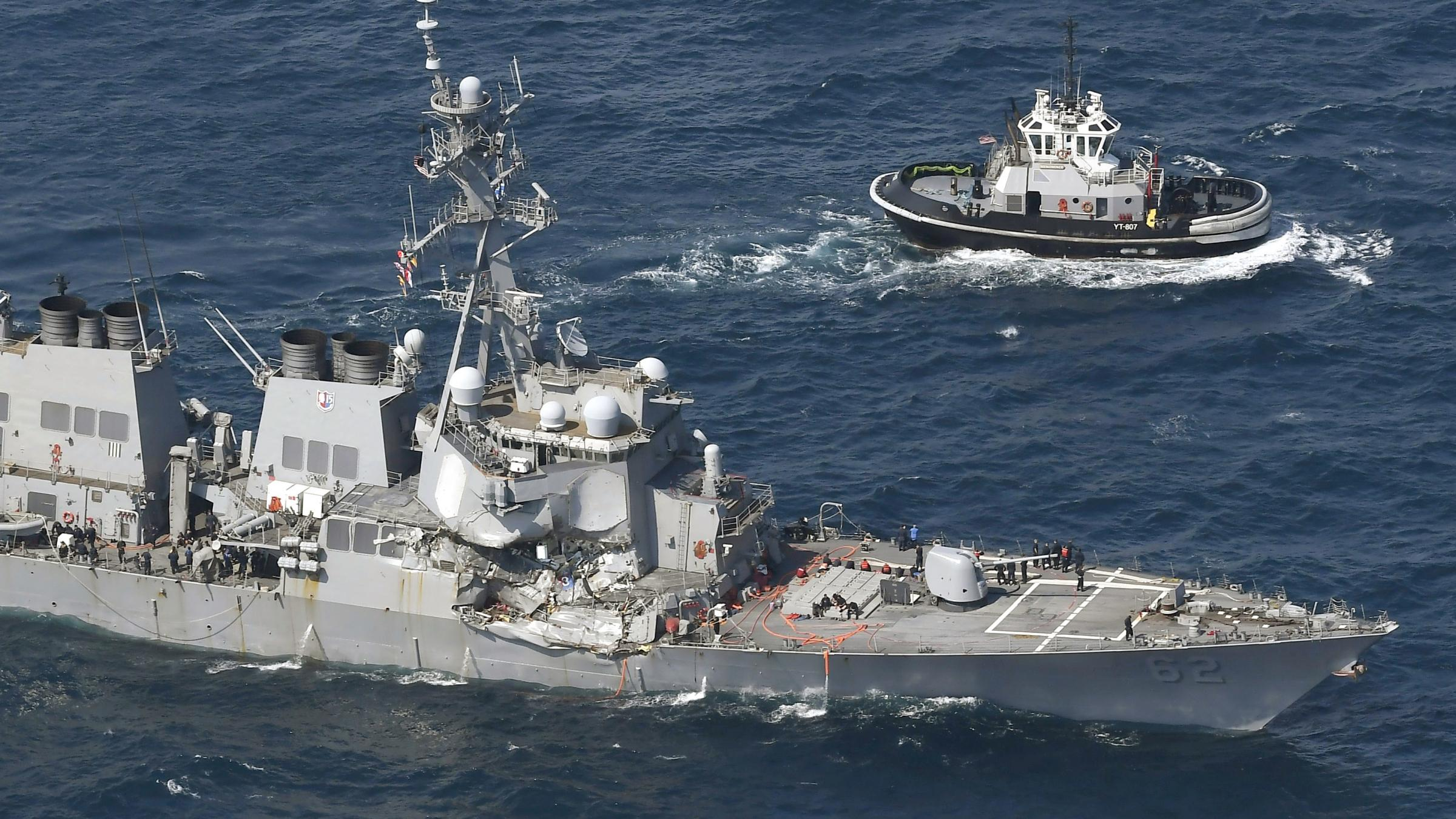 Seven missing, two injured after US Navy destroyer collides with merchant vessel